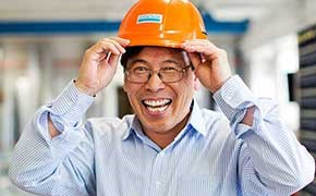 A person putting on a safety helmet.