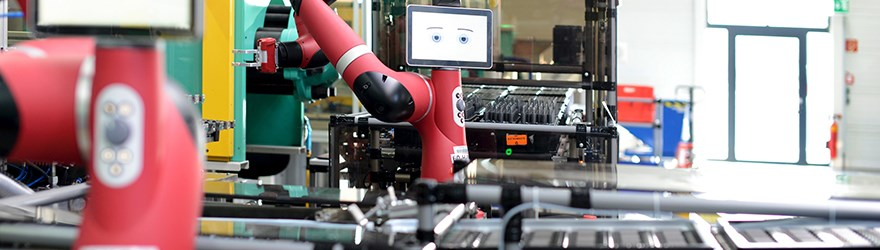 Two collaborative robots, so-called cobots.